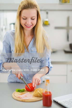Happy teenager girl making sandwich in kitchen Stock Photo - Budget Royalty-Free, Image code: 400-06853585