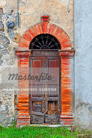 Wooden Ancient Italian Door in Historic Center Stock Photo - Budget Royalty-Free, Image code: 400-06859768