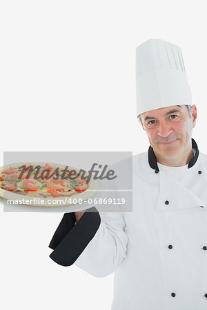 Portrait of male chef holding pizza over white background Stock Photo - Budget Royalty-Free, Image code: 400-06869119