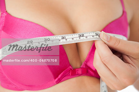 Extreme closeup of woman measuring chest in pink bra Stock Photo - Budget Royalty-Free, Image code: 400-06870708