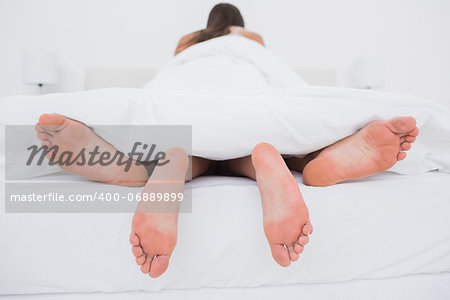 Rear view of a couple making love in bed Stock Photo - Budget Royalty-Free, Image code: 400-06889899
