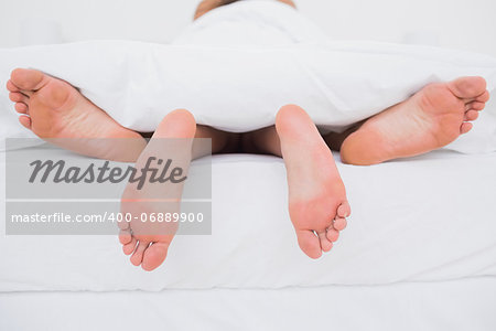 Rear view of a couple having sex in bed Stock Photo - Budget Royalty-Free, Image code: 400-06889900