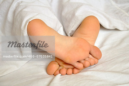 sleeping teen girl feet under the blanket Stock Photo - Budget Royalty-Free, Image code: 400-07035841