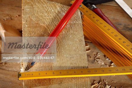 Carpenter's pencil and wooden meter on workshop Stock Photo - Budget Royalty-Free, Image code: 400-07046047