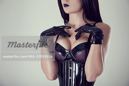Close-up shot of female breasts in latex bra, studio shot Stock Photo - Budget Royalty-Free, Image code: 400-07055016