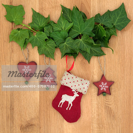 Christmas eve symbols of red stocking, tree, star and heart with ivy leaf sprigs over oak background. Stock Photo - Budget Royalty-Free, Image code: 400-07087002