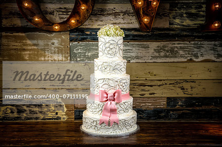 Image of a beautiful wedding cake with a rustic background Stock Photo - Budget Royalty-Free, Image code: 400-07111195