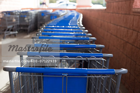 Many blue and gray shopping carts lined up and ready to go shopping. Stock Photo - Budget Royalty-Free, Image code: 400-07122939