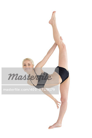Full length of a sporty young woman stretching body against white background Stock Photo - Budget Royalty-Free, Image code: 400-07178179