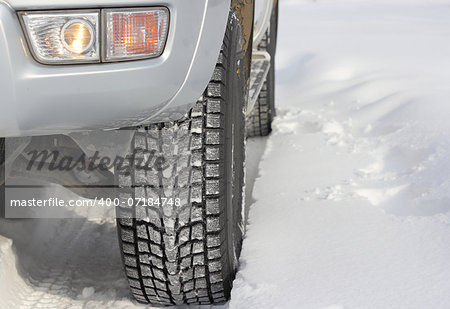 Snowy winter road ahead an unrecognizable car Stock Photo - Budget Royalty-Free, Image code: 400-07184748