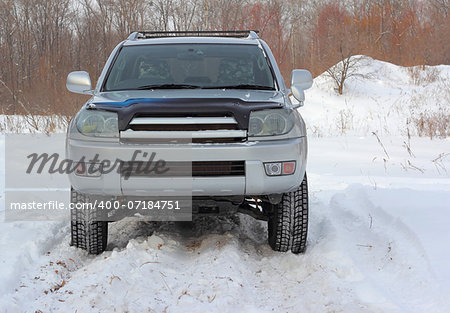 Snowy winter road ahead an unrecognizable car Stock Photo - Budget Royalty-Free, Image code: 400-07184751