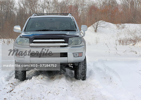 Snowy winter road ahead an unrecognizable car Stock Photo - Budget Royalty-Free, Image code: 400-07184752