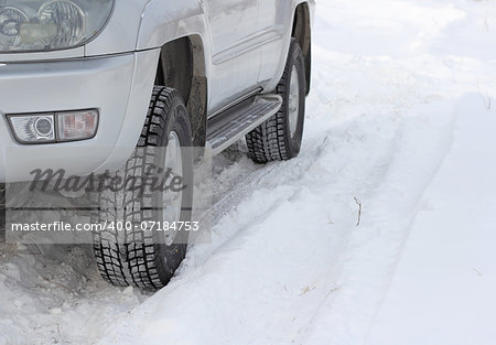 Snowy winter road ahead an unrecognizable car Stock Photo - Budget Royalty-Free, Image code: 400-07184753