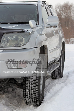 Snowy winter road ahead an unrecognizable car Stock Photo - Budget Royalty-Free, Image code: 400-07184754