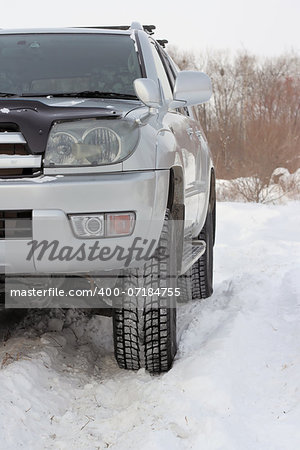 Snowy winter road ahead an unrecognizable car Stock Photo - Budget Royalty-Free, Image code: 400-07184755