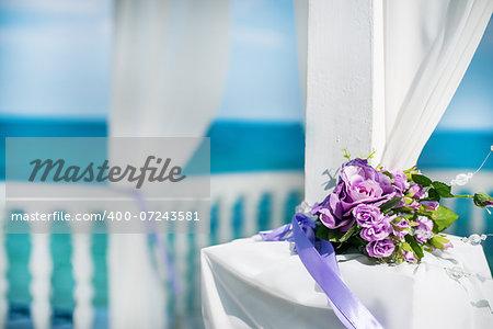 White wedding flower bouquet at the beach