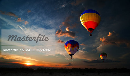 Colorful hot air balloon is flying at sunrise Stock Photo - Budget Royalty-Free, Image code: 400-07248879