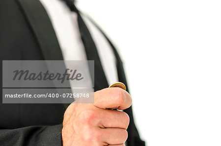 Closeup  of businessman hand flipping  a coin. Isolated over white background. Stock Photo - Budget Royalty-Free, Image code: 400-07258748