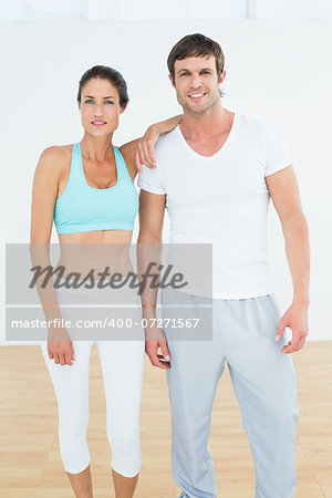 Portrait of a fit young couple standing in fitness studio Stock Photo - Budget Royalty-Free, Image code: 400-07271567
