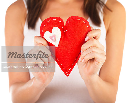 Picture of brunette woman holding red soft toy heart-shaped in hands, beautiful handmade present for Valentine day, romantic holiday, affection feelings, health care and medicine, love concept Stock Photo - Budget Royalty-Free, Image code: 400-07272530