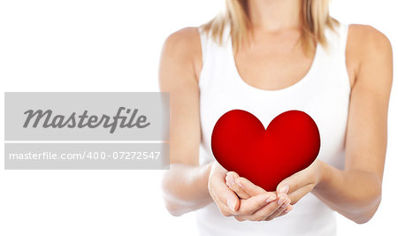 Healthy woman holding heart in hands, female body isolated on white background, conceptual image of health care and love, girl with symbol of Valentine's day, selective focus, shallow dof Stock Photo - Budget Royalty-Free, Image code: 400-07272547