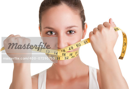 Woman with a yellow measuring tape around her mouth, isolated in white Stock Photo - Budget Royalty-Free, Image code: 400-07290753