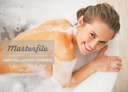 Smiling young woman laying in bathtub Stock Photo - Budget Royalty-Free, Image code: 400-07304835