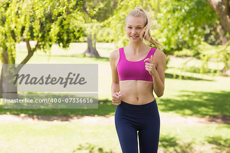 Portrait of a healthy and beautiful young woman in sports bra jogging in the park Stock Photo - Budget Royalty-Free, Image code: 400-07336616
