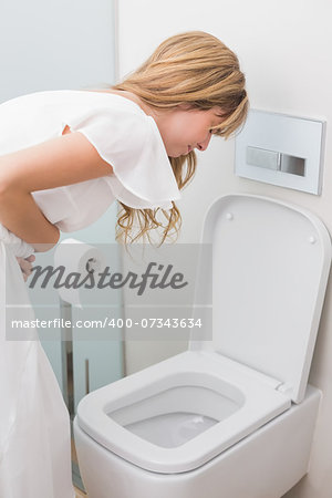 Young woman with stomach sickness about to vomit into a toilet Stock Photo - Budget Royalty-Free, Image code: 400-07343634