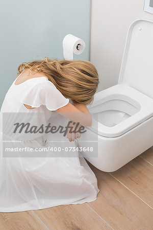 High angle view of a sick young woman sitting in the toilet Stock Photo - Budget Royalty-Free, Image code: 400-07343648
