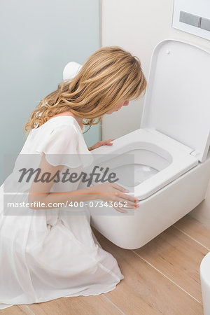 High angle view of a young woman about to vomit into a toilet Stock Photo - Budget Royalty-Free, Image code: 400-07343652