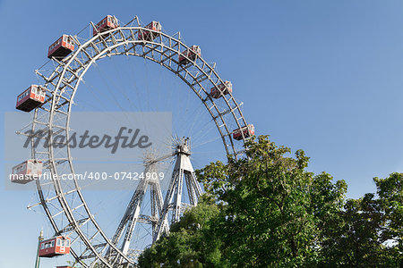The Wiener Riesenrad is a Ferris wheel at the entrance of the Prater amusement park in Vienna, It is one of most popular tourist attractions in Vienna. Austria Stock Photo - Budget Royalty-Free, Image code: 400-07424909