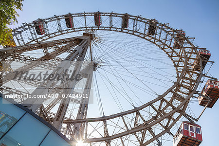 The Wiener Riesenrad is a Ferris wheel at the entrance of the Prater amusement park in Vienna, It is one of most popular tourist attractions in Vienna. Austria Stock Photo - Budget Royalty-Free, Image code: 400-07424911