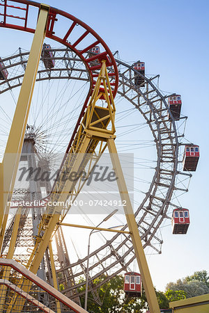 Wiener Riesenrad Ferris Wheel and Roller Coaster in the Prater amusement park in Vienna, Austria Stock Photo - Budget Royalty-Free, Image code: 400-07424912