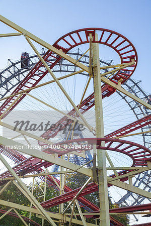 Wiener Riesenrad Ferris Wheel and Roller Coaster in the Prater amusement park in Vienna, Austria Stock Photo - Budget Royalty-Free, Image code: 400-07424913
