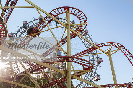 Wiener Riesenrad Ferris Wheel and Roller Coaster in the Prater amusement park in Vienna, Austria Stock Photo - Budget Royalty-Free, Image code: 400-07424914