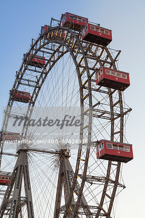 The Wiener Riesenrad is a Ferris wheel at the entrance of the Prater amusement park in Vienna, It is one of most popular tourist attractions in Vienna. Austria Stock Photo - Budget Royalty-Free, Image code: 400-07424915