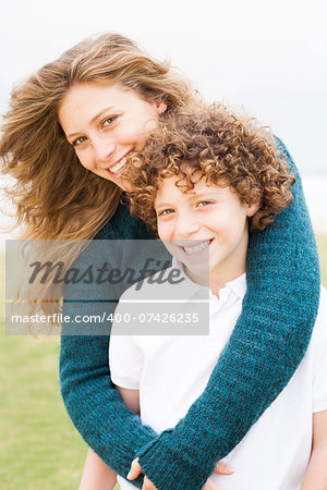 Happy mother playing with her son in the park Stock Photo - Budget Royalty-Free, Image code: 400-07426235