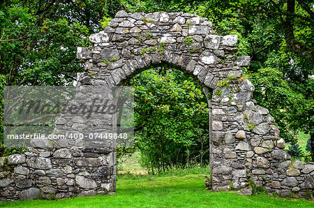 Old stone entrance wall in green landscaped garden Stock Photo - Budget Royalty-Free, Image code: 400-07449848
