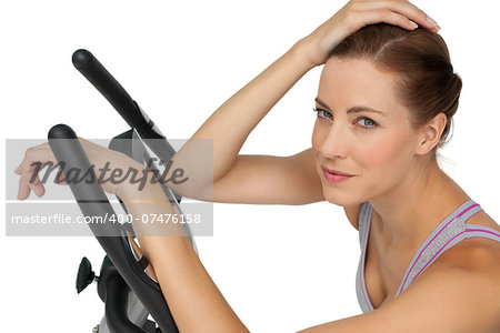 Close-up portrait of a beautiful young woman on stationary bike over white background Stock Photo - Budget Royalty-Free, Image code: 400-07476158