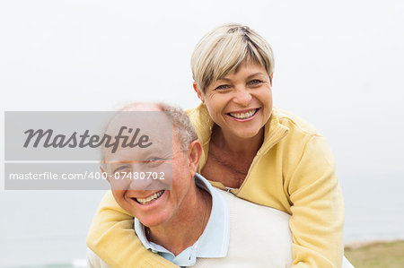 Smiling happy aged couple having fun in beach Stock Photo - Budget Royalty-Free, Image code: 400-07480702
