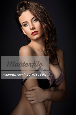 fashion model wearing a nice lace bra lingerie , looking in camera sensual with great hair style Stock Photo - Budget Royalty-Free, Image code: 400-07508461