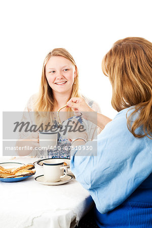 Mother and daughter having a Mother's Day tea party.  Mom is pouring tea.  White background Stock Photo - Budget Royalty-Free, Image code: 400-07510930