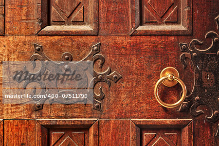 Closeup of old ornate wooden door with a gold door handle in Alba, Italy. Stock Photo - Budget Royalty-Free, Image code: 400-07511790