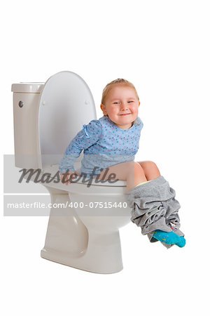 the little girl is sitting on toilet Stock Photo - Budget Royalty-Free, Image code: 400-07515440