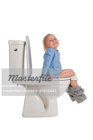 the little girl is sitting on toilet Stock Photo - Budget Royalty-Free, Image code: 400-07515443