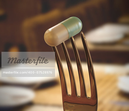 Inside the restaurant with a pill stuck in the fork. Concept of food supplement. Stock Photo - Budget Royalty-Free, Image code: 400-07528976