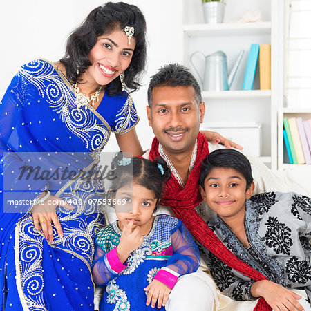 Portrait of Asian Indian family at home, happy parents and children in traditional sari. Stock Photo - Budget Royalty-Free, Image code: 400-07553669