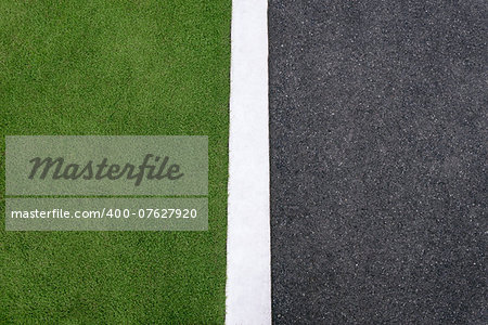 high angle view of lane and grass on roadside. Concept of environmental conservation, ecology, hard and soft surfaces. Copy space Stock Photo - Budget Royalty-Free, Image code: 400-07627920