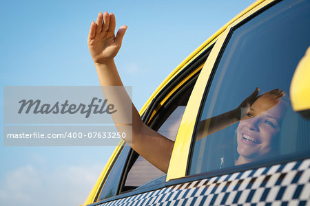 people travelling. Female passenger in taxi with arm outside of car window waving hand. Concept of freedom Stock Photo - Budget Royalty-Free, Image code: 400-07633250